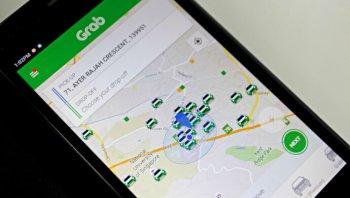 Uber bị cấm hoạt động, Grab bắt tay Here